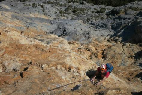 Following another perfect pitch at Presles. Overhanging rock, large rucksack, small arms. Tough work! Photo by Adam George.