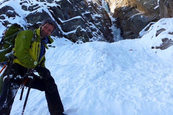 "Nick Bullock with his white afro hair-do after being ""strongly sluffed"" down a couloir."